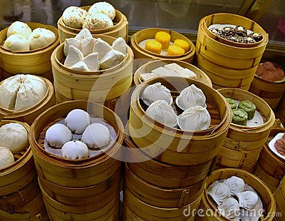 Dim sum, speciality of Cantonese cuisine, prepared and served in the small steamers