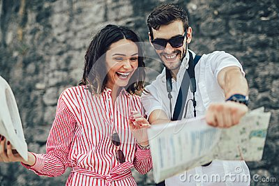 Tourist couple enjoying sightseeing, exploring city