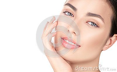 Beautiful brunette girl touching her face. Perfect fresh skin. Beauty portrait isolated on white background. Youth and skincare co
