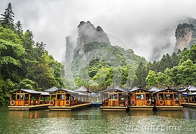 Baofeng Lake Boat Trip in a rainy day with clouds and mist at Wulingyuan, Zhangjiajie National Forest Park, Hunan Province, China,