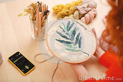 Inventive housewife embroidering picture for kitchen