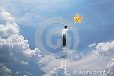 Businessman climb up on ladder to reach star, successful and win concept