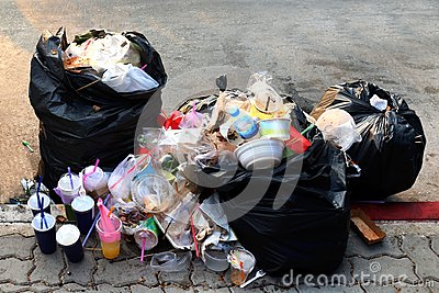 Pile of Garbage plastic black and trash bag waste many on the footpath, pollution trash, Plastic Waste and Bag Foam tray Garbage