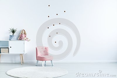 Star stickers on white wall with copy space in child`s room inte