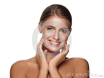 Portrait of a young smiling healthy and beautiful girl with nude makeup