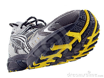 Running Shoe yellow black tread pattern tilted up