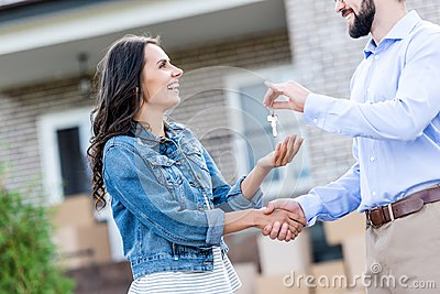 young happy woman buying new house and taking keys