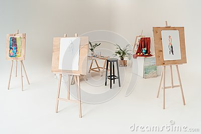 easels with paintings in empty