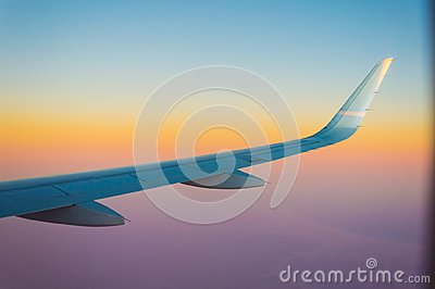 Airplane wing during an incredible sunset