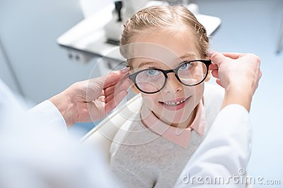 oculist and little child in glasses