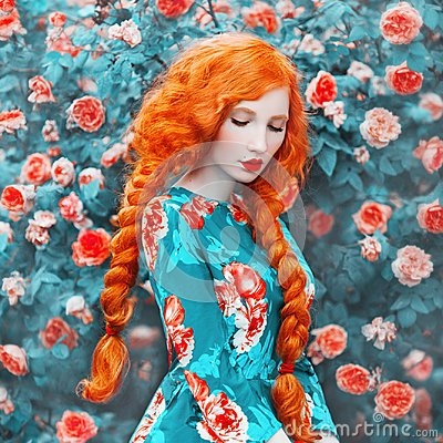 Young beautiful redhead girl with very long hair braided in plait on rose background. Fabulous renaissance woman in a flower dress