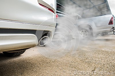 Incomplete combustion creates poisonous carbon monoxide from exhaust pipe of white car, air pollution concept