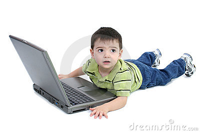 Adorable Boy With Laying On White Floor Working On Laptop