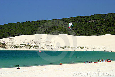 White sandy beach in Spain with crystal clear sea and blue sky