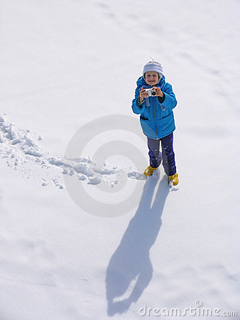 Young girl with photocamera
