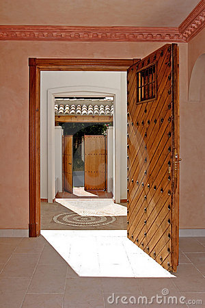View from inside a house, looking through two open doorways.