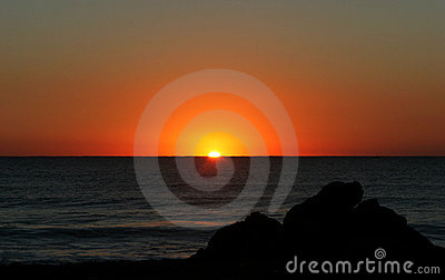 Beautiful golden sunrise in southern Spain as seen from the beach.