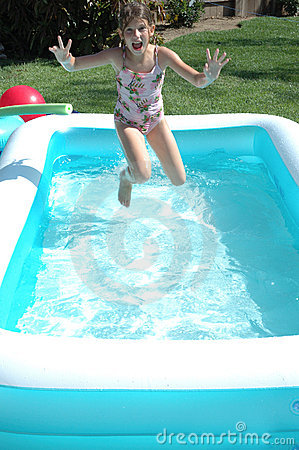 Girl jumping in pool