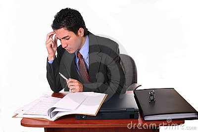 Businessman reading contracts