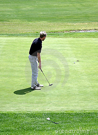 Man putting on green during game of golf