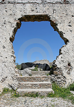 Hole in the wall of an ancient Spanish ruin