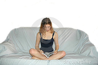 Girl on sofa reading