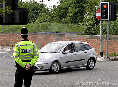 Policeman watching traffic