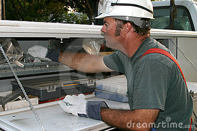 Electrician Reaching in Truck