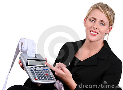 Business Woman Stressed or Confused Over Calculations