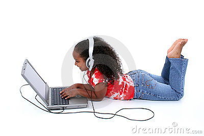 Adorable Six Year Old Girl Sitting On Floor With Laptop Computer