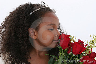 Beautiful Little Princess With Tiara Smelling Roses Over White