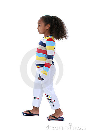 Beautiful Six Year Old Girl Walking Profile In Summer Clothes