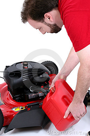 Man Putting Gas Into Lawn Mower Over White