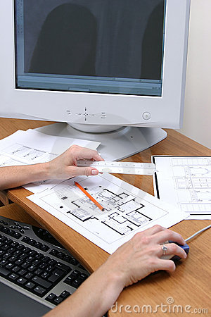 Persons hands working on a drawing and loading to a computer