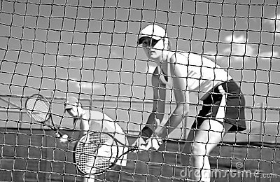 Woman tennis players looking at camera through net waiting to play while looking at camera