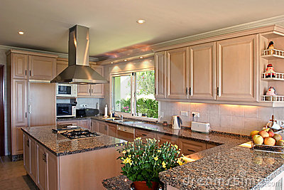 Kitchen interior of large spanish villa. With fresh flowers and fruit
