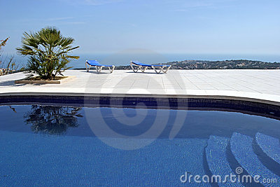 Amazing swimming pool in spanish villa with incredible views to the town and sea below.