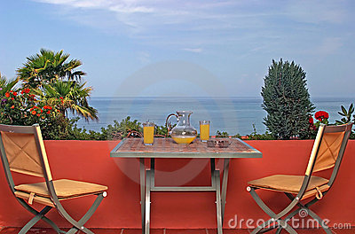 View of sea and blue sky from terrace in Spanish villa.