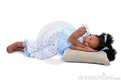 Beautiful Six Year Old Girl Laying Down In Pajamas Over White