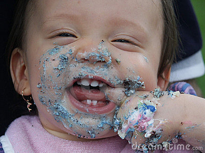 Baby's face with cake