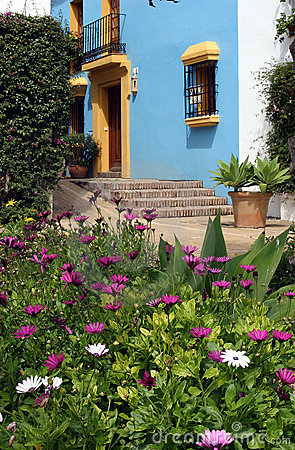 Spanish house in pueblo with blue walls and yellow trim