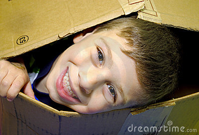 Child Peeking out of a Box