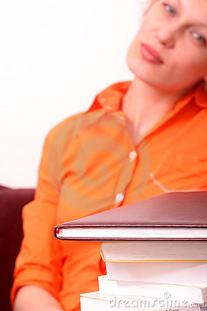 Adult tired woman with books