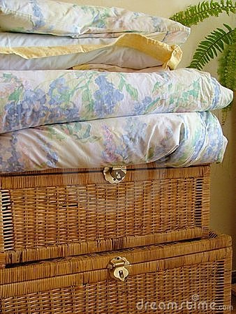 Wooden chest and linens