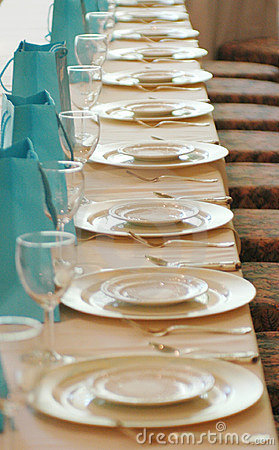 Glasses and plates in a row