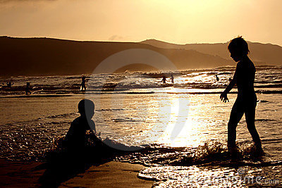 Children Playing on Sunset Beach