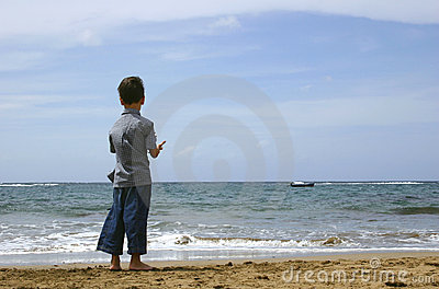 Boy Looking at the Ocean