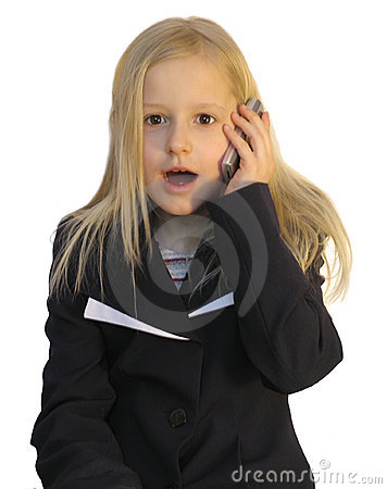 Young girl dialing phone number