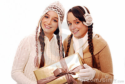 stock image of teenagers holding christmas gift