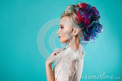 Beautiful woman with creative hair coloring. Stylish hairstyle, informal style.